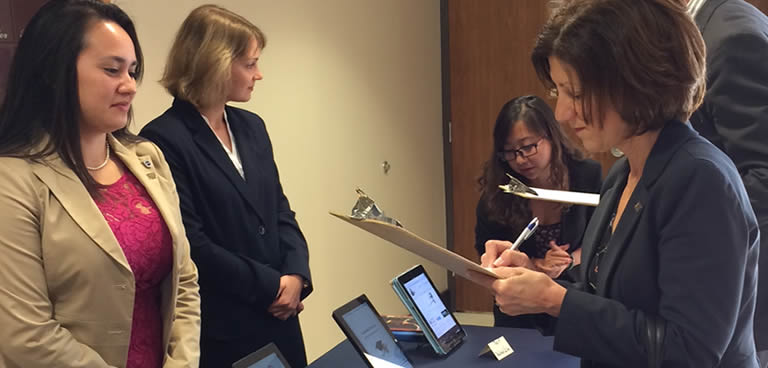 Female judge writing on a pad at the 2014 Career Portfolio Competition