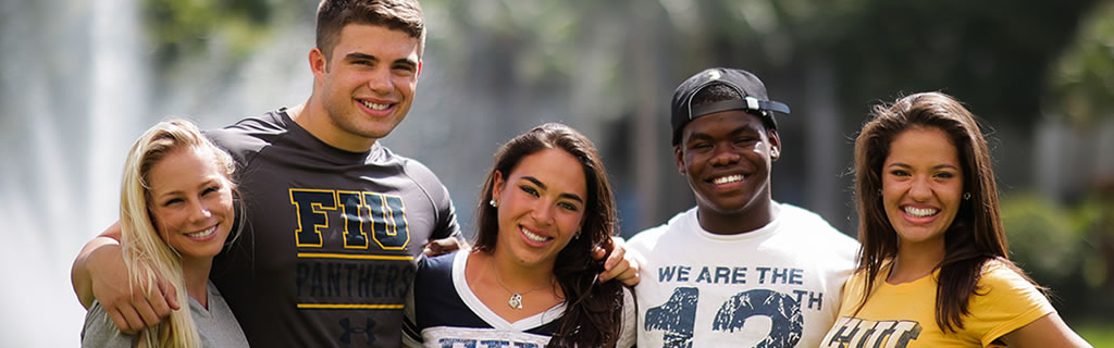 Group of multicultral students wearing FIU gear