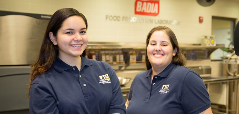 FIU hospitality management student and winners of the Red Robin Golden Robin Contest Michelle Nicole Diaz and Yolanda Marie Suarez