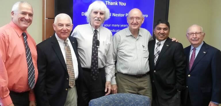 Professors David Talty and Nestor Portocarrero standing with Chaplin School administrators at retirement reception