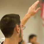 FIU hospitality management student raising hand in classroom