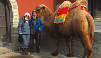 Student and local posing with a camel