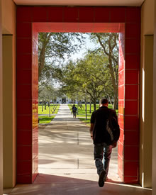 student_walking_doorway_220x275