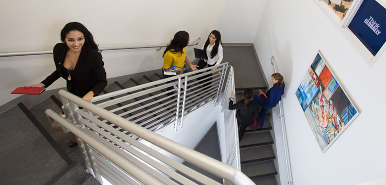 Students climbing stairs in FIU's Chaplin School of Hospitality & Tourism Management