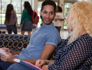 Male student talking with female student in FIU's Wolfson University Center